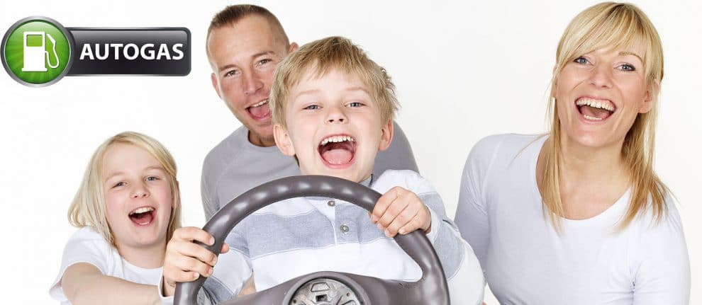 Family Driving A Roadster At Home